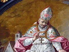 """LXXXVIII 31 października 2020 sobota Przybysz znad Jeziora Bodeńskiego - św. Wolfgang z Ratyzbony Przyszedł na świat w pierwszej połowie X wieku w Szwabii. Najprawdopodobniej miejsce jego urodzenia to dzisiejsze Pfullingen.  Wychował się w słynnym, benedyktyńskim opactwie leżącym na wyspie Reichenau na Jeziorze Bodeńskim. W 956 roku jego przyjaciel Henryk Babenberg został arcybiskupem Trewiru. Od tego momentu Wolfgang zaczął pełnić obowiązki jego kanclerza.  11 lat później wstąpił do benedyktynów w szwajcarskiej miejscowości Eisiedeln, natomiast w 969 roku święty Ulryk z Augsburga wyświęcił go na biskupa. Odtąd Wolfgang głosił Dobrą Nowinę w prowincji Noricum, jak od czasów rzymskim nazywano tereny dzisiejszej Austrii. Przebywał także na Węgrzech, jako misjonarz w pogańskim jeszcze w tamtym okresie kraju.  W 972 wyznaczono go na biskupa Ratyzbony. Wówczas to zrzekł się swych biskupich praw w Czechach, dzięki czemu powstać mogła diecezja praska. Zrezygnował także z pełnienia prestiżowej funkcji opata klasztoru świętego Emmerama. Scedował ją na błogosławionego Ramwolda, by ten zaprowadził tam nowe zasady i reguły.  Prowadzący surowy i ascetyczny żywot Wolfgang wsławił się zakładaniem nowych klasztorów i reformowaniem tych, które istniały już wcześniej. Szczególnie troszczył się o biednych i chorych. Nalegał także na dalszą – dziś powiedzielibyśmy """"ustawiczną"""" - edukację osób należących do stanu duchownego. Uchodzi także za nauczyciela cesarza Henryka II oraz królowej węgierskiej, błogosławionej Gizeli.  Pod koniec życia, jako pustelnik, zamieszkał nad jeziorem, które z czasem nazwano na jego cześć Wolfgangsee. Z tym okresem w biografii świętego wiąże się sporo legend. Ponoć żyjący wówczas w jaskini Wolfgang spotkał któregoś dnia leśników, pracujących przy wyrębie lasu. Na widok zmęczonych ludzi użył swych mocy, i między pobliskimi skałami wytrysnęło źródełko z wodą, dzięki czemu drwale mogli ugasić swe pragnienie. Od tego czasu woda wypływająca z owego źródełka uchodz"""